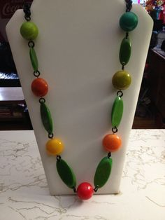 Sliced and sphere bakelite necklace with a black celluloid chain