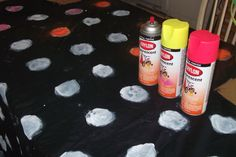 Halloween black light dots room. black walmart sheet. walmart neon/glow in dark spray paint. First paint dots white, then paint over white with glow in dark paint.