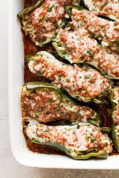 Poblano Peppers stuffed with brown rice, chicken and topped with enchilada sauce and cheese. Use a rotisserie chicken to make this an easy dinner! | dinner ideas | chicken recipes | mexican food recipes | #chicken #poblanopeppers #peppers #brownrice #cheese #cooking #dinner #recipes #mexican #bakedpeppers #southwest Baked Peppers, Stuffed Poblano Peppers, Chili Recipes, Mexican Food Recipes, Pepper Recipes, Dinner Recipes, Dinner Ideas, Healthy Ground Beef, How To Cook Rice
