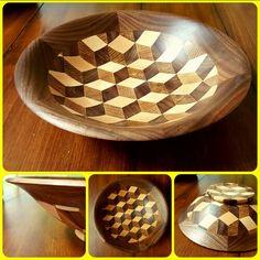 Segmented turned bowl made of walnut, maple and red oak. By Joel J Garcia
