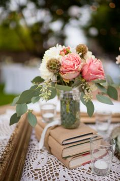 Instead of vintage books for centerpieces, cover regular books with paper bags (school style).