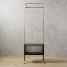 Shop valet gold clothing rack. Ideal in the entry, guest room, or anywhere you need a little extra storage, handmade metal and mango wood valet transforms any space into an impromptu closet.