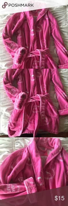 Victoria's Secret pink bath robe Baby pink cotton bathrobe! Comes down about mid thigh. Perfect material for putting on right out of shower while you are getting ready. It has a small stain on the front by right pocket (shown in picture), but it is barely visible when it is on.  Quality heavy duty bathrobe. PINK Victoria's Secret Intimates & Sleepwear Robes