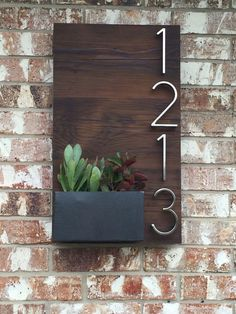 Beautiful custom house numbers plaque utilizing reclaimed wood and handmade metal planter box for succulents. My amazing man made! Handmade Furniture - http://amzn.to/2iwpdj4: