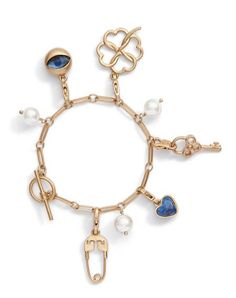 """Introducing our new Heirloom Charm Collection, based on Tory's own jewelry finds and treasured keepsakes. The Charm Bracelet features several symbols of luck and love, including a lapis heart, a key, an open clover, a glass """"evil eye"""" and a safety pin amid Swarovski-crystal pearls."""