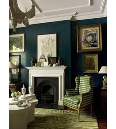 Living Room: Navy walls, muted white mantle and ceiling with green and gold accents with furnishings. Classic.