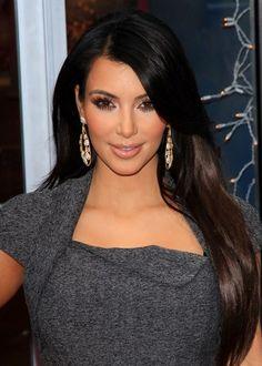 Kim Kardashians sleek, brunette hairstyle