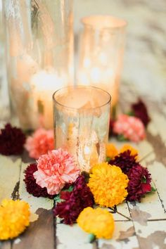 Carnations and candles wedding ceremony decor idea