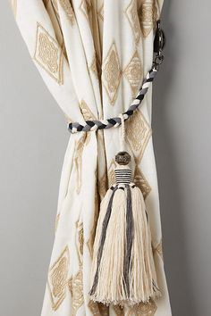 Discover unique curtain rods, finials and tiebacks at Anthropologie, including the season's newest arrivals. Curtain Tie Backs Tassels, Tie Top Curtains, Ikat Curtains, Unique Curtains, Home Curtains, Curtain Ties, Curtain Call, Moroccan Curtains, Bombay