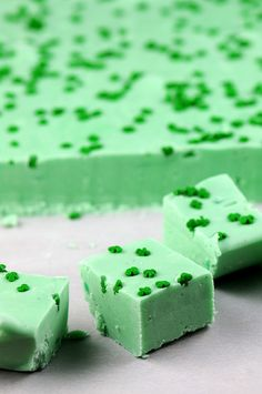 Drunken Grasshopper Fudge  2 cups granulated sugar  4 oz. unsalted butter  1/3 cup heavy cream  ¼ cup Crème de Mente  ¼ cup Crème de Cocoa  1 cup white chocolate chips  1 cup mint chips (Guittard makes some)  1 tsp. vanilla bean paste (or extract)  7 ounce jar marshmallow crème  Shamrock sprinkles