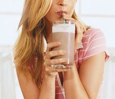 Stay-Slim Holiday Food Swaps: Cookies at the office, hors d'oeuvres at parties: High-calorie nibbles are everywhere! The fix: Enjoy a high-protein breakfast. People who did so ate fewer calories all day, research shows. Protein ups levels of satiety hormones, so you'll be less likely to snack. Sip this smoothie: Blend 1 cup nonfat Greek yogurt with 1/2 cup canned pumpkin puree, 1 banana, 2 tsp almond butter, 1/2 cup vanilla soymilk, 1/4 tsp pumpkin-pie spice and 5 ice cubes. #SelfMagazine
