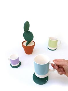 Cacti Coasters are designed to protect work surfaces whilst having the remarkable ability to blend into your environment by transforming into different shapes of cacti. Each product is comprised of a terracotta pot, a birch plywood top, and six green water resistant discs precisely machined from high quality engineered wood. Each disc is a slightly different size, providing surface protection for up to seven cups. This unique design allows you to securely interlock each coaster to build…
