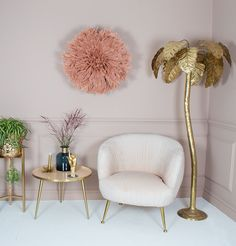 Gold decor styling tips. Accentuate your home decor with stylish accents, like this lavish gold palm tree floor lamp and feather juju hat wall decor. Gold Floor Lamp, Tree Floor Lamp, Floor Lamps, Salon Interior Design, Beauty Salon Interior, Pink Accent Chair, Accent Chairs, Living Room Decor, Bedroom Decor