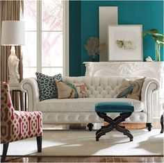 white tufted sofa, teal wall + accents, substitute orange for red?