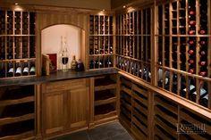 Beautiful custom #wine room built with sliding walnut display drawers #winestorage