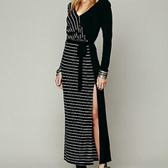Free People Maxi Dress Long sleeve maxi dress with alternating solids and stripes that rave down and across a long silhouette. V neckline in front and back. High slit on left bottom hem. Black ribbon style waist belt. Elastic waist. 85% polyester, 10% rayon, 5% spandex. Machine wash cold. Import. Models height: 5'10 wearing a small. Length is approx 55 inches. I'm 5'3 and it barely drags the ground. It looks perfect. Free People Dresses Maxi