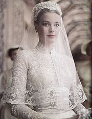 April American actress Grace Kelly marries Prince Rainier of Monaco. Photo: Princess Grace in her wedding dress, a gift from the MGM studio, designed by Academy Award Winning Costumer Helen Rose. Celebrity Wedding Dresses, Celebrity Weddings, Royal Wedding Dresses, Bridal Dresses, Princesa Grace Kelly, Grace Kelly Wedding, Grace Kelly Style, Kate Middleton Wedding Dress, Helen Rose