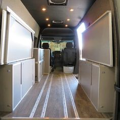 Terracamper's dual-sided Sprinter bed folds away to create plenty of cargo space