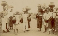 Three Tagalog milk-carriers and five Tagalog women with pots on their heads, coming in to Manila. January  1901