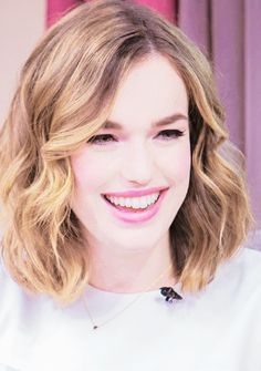 Elizabeth Henstridge with shoulder length slightly wavy hair. If I were to ever cut my hair short again, it might look like this.