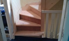 wooden staircase leading up to the loft conversion