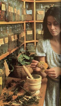 This is not a witch but none other than our basic run of the mill herbalist doing her trade of making homeopathic remedies for the sick and infirmed as my self. A word to the wise should be sufficient, learn this dieing art before you need it. It works. Who Started calling women witches... THE CHURCH!