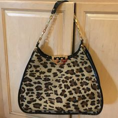 Tory Burch Limited Edition bag!!weekend Special This is a large bag in pressed condition animal print with hair looks great gold hardware lightly scratched there were few nick that I had touched up bag looks great !! Inside & outside no damage great tb collector piece Tory Burch Bags Shoulder Bags