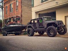 Jeep Wrangler & Black Boat.