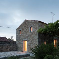 Par-Do transforms stone-walled Portuguese barn into compact residence