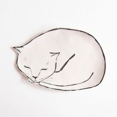The Brooklyn-based illustrator manifests her flower and cat obsession onto dishes and vases to charming result