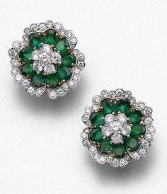 PAIR OF EMERALD AND DIAMOND FLOWER EARCLIPS, VAN CLEEF & ARPELS, NEW YORK.  The flowerheads set centrally and around the borders with 70 round diamonds weighing approximately 2.80 carats, further decorated with 18 oval emeralds weighing approximately 5.25 carats, mounted in 18 karat gold and platinum, signed Van Cleef & Arpels, numbered NY 64898. With signed box.