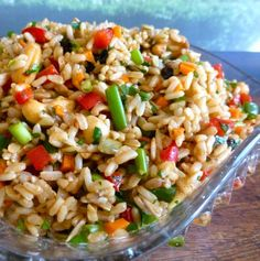 "Brown Rice Salad: ""A delicious, nutty rice salad that's a meal on its own or fantastic at a BBQ as an impressive side dish."""