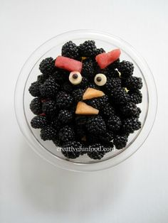 The face is made from blackberries (eyebrows), apples and blueberries (eyes) and cantaloupe (beak). To keep the apples from browning I dipped them in lemon juice. Food: Angry Birds Birthday Party Ideas -