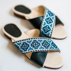 100% hand-embroidered and handcrafted in Palestine.  Our Tatreez Cross Sandals are a modern take on a traditional Palestinian art form. These sandals are hand embroidered by refugee and low-income women artisans with traditional Palestinian tatreez design, and then handcrafted with locally sourced leather Soft leather insole and leather lining for a very comfortable fit. Leather and rubber outsole. Ethical fashion from Palestine, fair trade certified by Fair Trade Federation. Trade Federation, Palestine, Ethical Fashion, Fair Trade, Soft Leather, Artisan, Footwear, Traditional, Fit