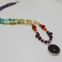 Chakra Awakening Crystal Gemstone Necklace | $175 Reconnect with your roots through the red, awaken your power in the yellow and infuse your being with heavenly energy in blue.