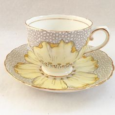 English Bone China:A show-stopping single, large, fully open yellow flower dominates the design of this dainty teacup and saucer set by Tuscan Bone China. Tea Cup Set, Tea Cup Saucer, Tea Sets, Vintage Cups, Vintage Tea, Yellow Cups, Bone China Tea Cups, Coffee Set, My Tea