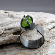 Raw Peridot Sterling Silver Ring by ElementalAlchemist. I love the green on black. Stone Jewelry, Metal Jewelry, Jewelry Art, Sterling Silver Jewelry, Jewelry Rings, Jewelry Design, Jewellery Box, Handmade Rings, Handmade Jewelry