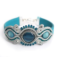 Items similar to MADE TO ORDER Capri blue soutache bracelet gray blue eco-leather jewelry shiny mother of pearl hand embroidered application on Etsy Soutache Bracelet, Soutache Jewelry, Beaded Jewelry, Jewelry Bracelets, Handmade Necklaces, Handmade Jewelry, Unique Jewelry, Capri Blue, Bead Embroidery Jewelry