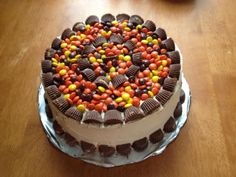 Reeses Cake - Chocolate cake covered in Peanunt Butter BC with Reeses PB cups and peices.
