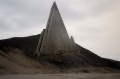 Abandoned Places  - Ryugyong Hotel- Pyongyang, North Korea *** Note that this image  is a Fake! real building however. just not in the hillside location