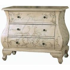"Hand-painted bombe chest with 3 drawers and a script motif.   Product: ChestConstruction Material: WoodColor: Antique whiteFeatures:  Hand-paintedThree drawers Bombe shaped Dimensions: 28"" H x 33"" W x 16"" D"