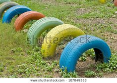 old  tires with colorful paint on a playground by krungchingpixs, via ShutterStock