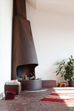 There is a limit on when and how much wood you can burn in CA. Though you can buy other things to burn (cleaner burning logs made from cardboard and such). I love outdoor fireplaces, more than indoor ones.