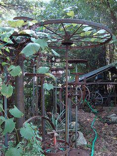 Wade Wharton's Art Environment...old wheel would make a fabulous clothes line
