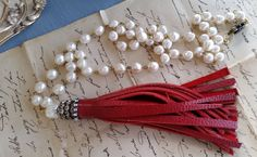 Hand Cut Red Leather Tassel Necklace Beaded by Lizzietishboutique