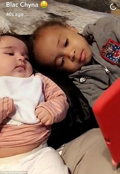 Doting big bro:On Saturday night Blac Chyna shared a Snapchat of son King Cairo showing his baby sister Dream how to send emojis