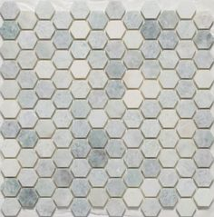 Grey and white hexagon tiles. Could tie together the creams that are in the bathroom?