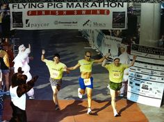 A team of three crossing the line together