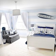 A surfer toddler room. I used a pale blue and white color palette and accented the room with ssailboats, a boat helm, anchors, and other nautical elements. Boys Nautical Bedroom, Surf Bedroom, Boy Toddler Bedroom, Big Boy Bedrooms, Toddler Rooms, Kids Bedroom, Boy Rooms, Boys Surf Room, Surfer Room