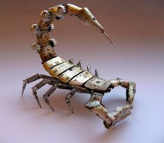 Chicago-based jeweler Justin Gershenson-Gates has created these scorpions, spiders, and other insects out of old watch parts, and in some instances light bulbs. His work reminds me of Mike Libby's work in which he uses the inner workings of antique watches, as well as random components from oldtypewritersand sewing machines, to reimagine real bugs as works of steampunk art (see These Bugs Got Steampunked).You can purchase some of Justin's creations via his Etsy shop.
